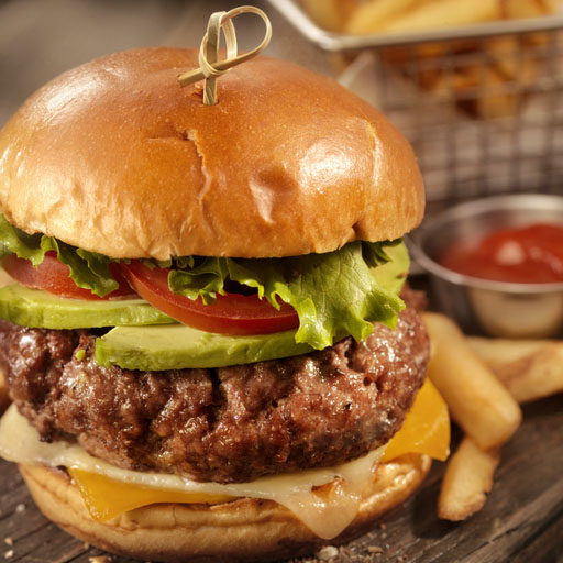 Avocado Cheeseburger with a Basket of Fries